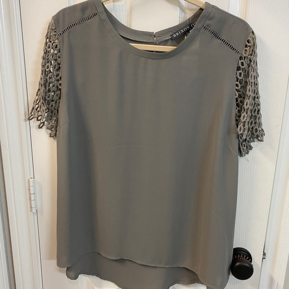 Gray blouse with lace like detailing on sleeve